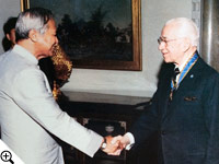 Thailand's Prime Minister Prem Tinsulanonda congratulates Herbert W. Armstrong for the royal Thai decoration conferred on behalf of Thailand's King Bhumibol.